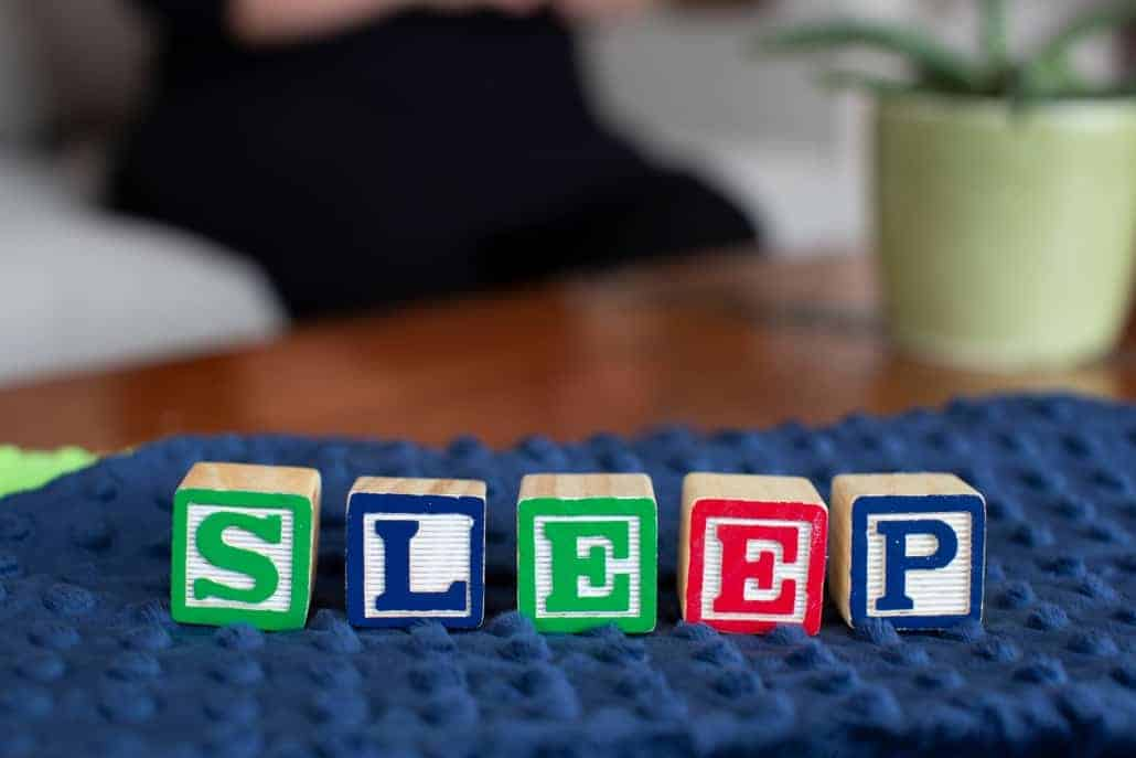 "Child Blocks Spelling ""Sleep"""