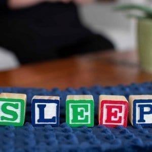 "Child Blocks Spelling ""Sleep"""